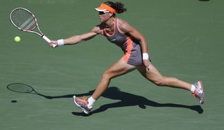 Samantha Stosur, of Australia, returns a shot to Varvara Lepchenko in the third round of play at the 2012 US Open tennis tournament,  Friday, Aug. 31, 2012, in New York. (AP Photo/Mike Groll)