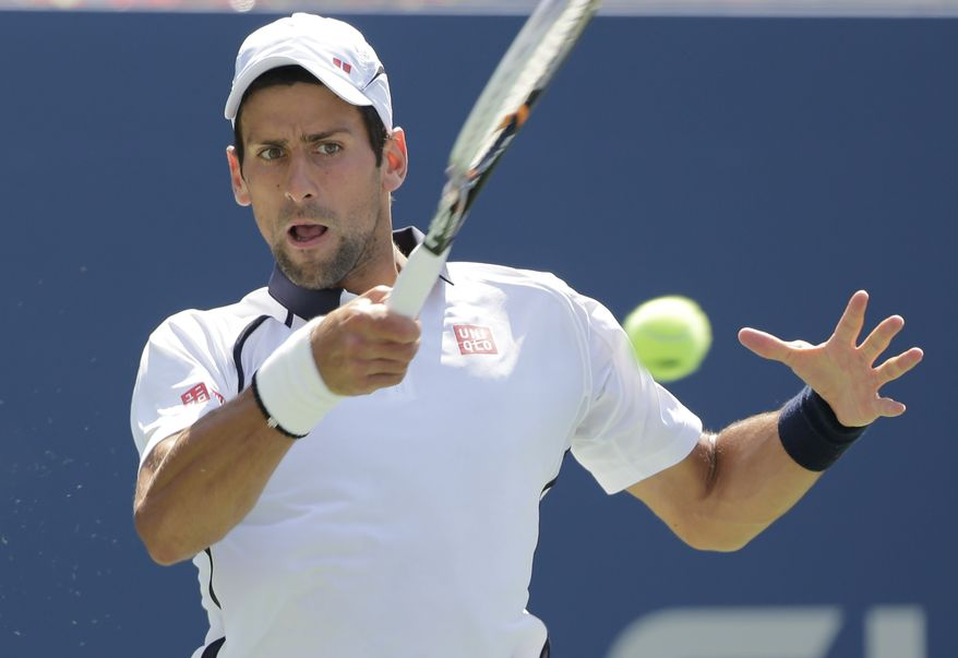 Serbia's Novak Djokovic returns a shot to Brazil's Rogerio Dutra Silva in the third round of play at the 2012 US Open tennis tournament,  Friday, Aug. 31, 2012, in New York. (AP Photo/Mike Groll)