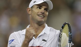 Andy Roddick reacts after beating Australia's Bernard Tomic in the third round of play at the 2012 US Open tennis tournament, Friday, Aug. 31, 2012, in New York. (AP Photo/Charles Krupa)