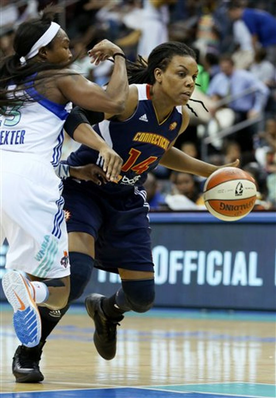 ** FILE ** Connecticut Sun guard Tan White (14) drives past New York Liberty guard Cappie Pondexter, left, during a WNBA basketball game at the Prudential Center, Thursday, Aug.16, 2012, in Newark, N.J. (AP Photo/John Minchillo)