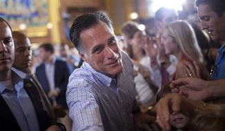 ** FILE ** Republican presidential candidate, former Massachusetts Gov. Mitt Romney shakes hands during a campaign rally, Saturday, Sept. 1, 2012, in Cincinnati, Ohio. (AP Photo/Evan Vucci)