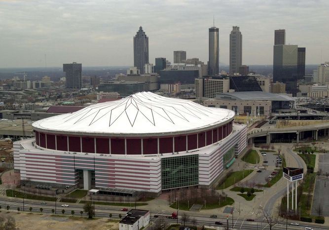 ** FILE ** This Feb. 28, 2001, file photo shows an aerial view of the Georgia Dome in Atlanta. Authorities say a 20-year-old man who plunged about 35 feet from the Georgia Dome's upper level and struck another fan during the Tennessee-North Carolina State college football game has died. (AP Photo/Atlanta Journal-Constitution, Rich Addicks)