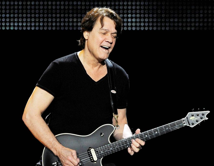 ** FILE ** This June 1, 2012 photo shows guitarist Eddie Van Halen of the band Van Halen performing in Los Angeles. Van Halen underwent an emergency surgery for the digestive disease diverticulitis and is canceling his tour in Japan to recover. (Associated Press)
