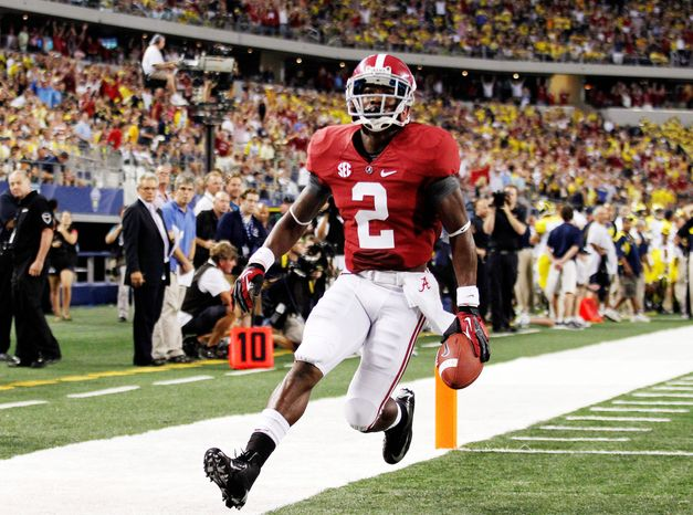 Wide receiver DeAndrew White helped No. 2 Alabama get off to a good start in its national title defense by scoring this touchdown against No. 8 Michigan in a 41-14 rout Saturday at Cowboys Stadium in Arlington, Texas. (Associated Press)