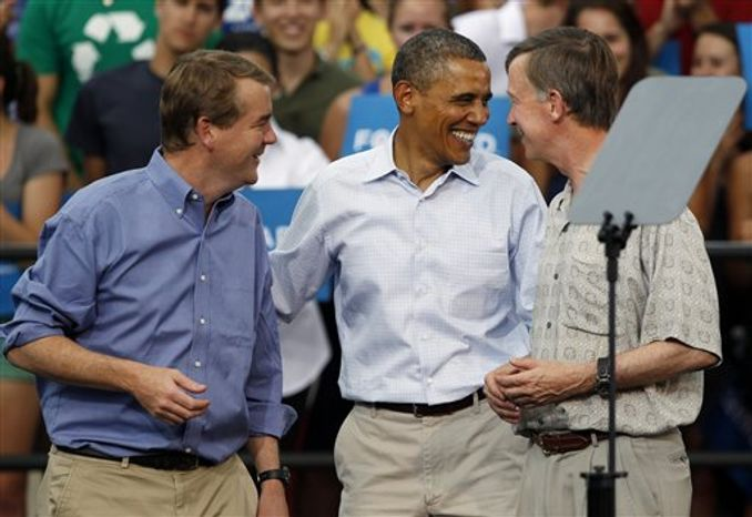 President Barack Obama, center, jokes with Sen. Michael Bennet, Colorado Democrat, left, and Colorado Gov. John Hickenlooper after Obama's campaign stop on the campus of the University of Colorado in Boulder, on Sunday, Sept. 2, 2012. (AP Photo/David Zalubowski)