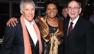 """Composer Bert Bacharach (left) and lyricist Hal David (right) pose with singer Dionne Warwick, their longtime collaborator, at the """"Love, Sweet Love"""" musical tribute to Mr. David on his 90th birthday in Los Angeles in October 2011. (AP Photo/Vince Bucci)"""