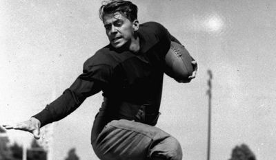 A posed action photo of Ronald Reagan playing the doomed Notre Dame halfback George Gipp in the 1940 film Knute Rockne - All American. (Associated Press)