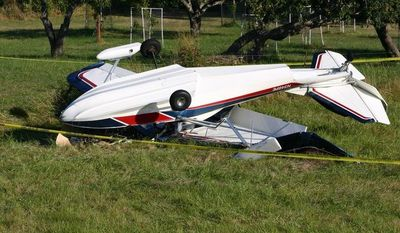 "The plane piloted by ""Jonathan Livingston Seagull"" author Richard Bach lies overturned after crashing in a field on Friday, Aug. 31, 2012, in Friday Harbor, Wash. (AP Photo/Journal of the San Juan Islands, Steve Wehrly)"