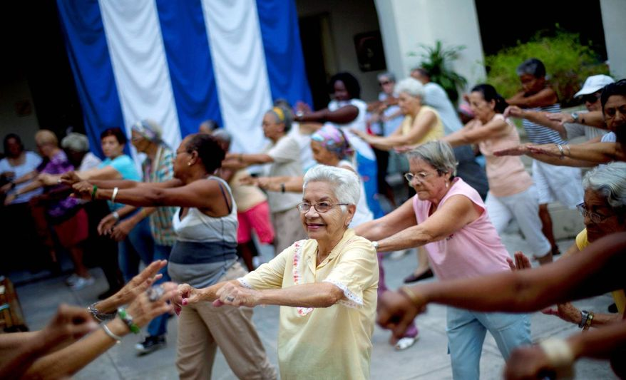 Women exercise at a senior center that provides retirees with medical attention, meals and social activities, in Havana. Cuba has the oldest citizenry in Latin America, a phenomenon fueled by low birth rates and long life expectancies, plus the migration of young people and women. The government has postponed the retirement age. (Associated Press)