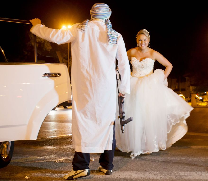 Associated press A Romanian bride enters a limousine as a mock kidnapper with a toy weapon holds the door for her at the Triumph Arch in Bucharest, Romania. The ancient Romanian tradition of bride stealing is getting bigger, brasher and an increasingly more common sight in the Romanian capital.