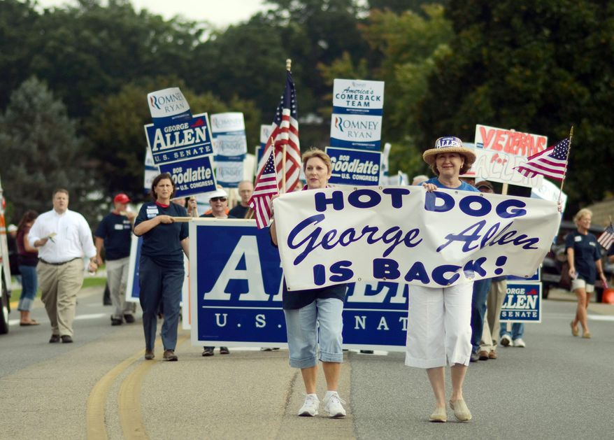 Republican volunteers march in support of George Allen during the Labor Day parade on Monday in Buena Vista, Va., a small town on the western slopes of the Blue Ridge Mountains. The parade was the first big political event of the season in the Shenandoah Valley and featured both candidates for Senate. (Associated Press)