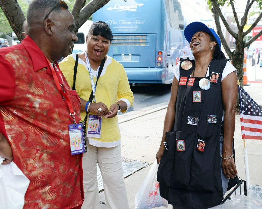 Claudia Blakemore, laughing with Howard Foreman of Louisiana and Audrey Cumby of Texas, has a lucrative business in souvenirs. (Barbara L. Salisbury/The Washington Times)