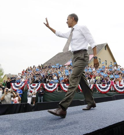 President Obama gets a warm greeting as he walks on stage for a campaign rally Saturday in Urbandale, Iowa. After four years, Americans have had a chance to get to know his personality, tastes and foibles. (Associated Press)