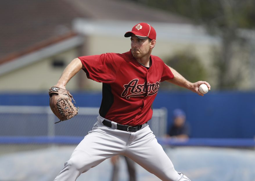 Houston Astros starting pitcher Zach Duke winds up in their spring training baseball game \against the Toronto Blue Jays in Dunedin, Fla., Saturday, March 10, 2012.  (AP Photo/Kathy Willens)