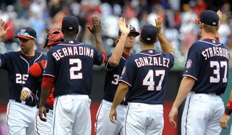Washington Nationals relief pitcher Tyler Clippard, center, high-fives Gio Gonzalez (47) as Adam LaRoche (25), Roger Bernadina (2) and Stephen Strasburg (37) celebrate after defeating the Chicago Cubs 2-1 during a baseball game at Nationals Park, Monday, Sept. 3, 2012, in Washington. (AP Photo/Richard Lipski)