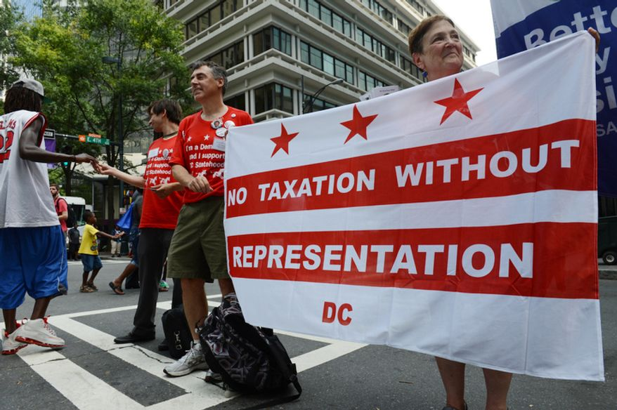 Proponents of DC statehood, from left, David Lowell, John Cappozi and Ann Howell hand out literature outside the Democratic National Convention. DC Mayor Vincent Gray will speak during the convention. (Barbara Salisbury/ The Washington Times)