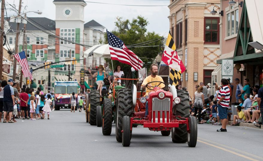Farm trackers ride in the Gaithersburg end-of-summer Labor Day parade on Monday, Sept. 3, 2012, in Gaithersburg, Maryland.  (Craig Bisacre/The Washington Times)