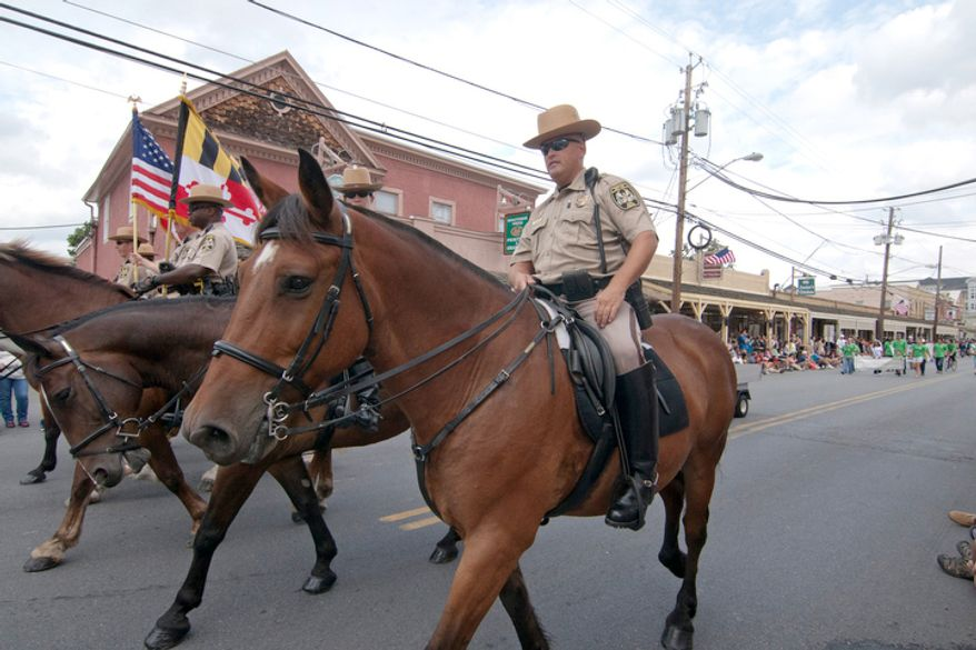 Maryland mounty police ride during the Labor Day parade.  (Craig Bisacre/The Washington Times)