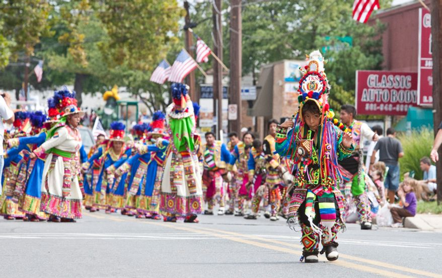 Multicultural performers dance in the Labor Day parade. Over 80 groups participated in the three hour long parade that went down E. Diamond Ave.  (Craig Bisacre/The Washington Times)