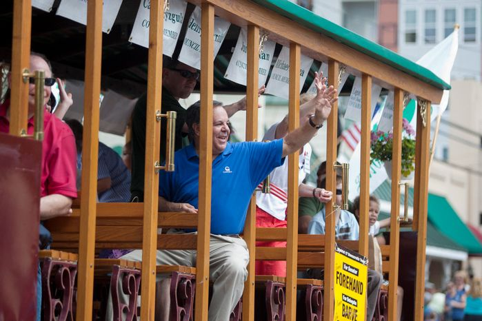 City Council Members wave to spectators during the Labor Day parade.  (Craig Bisacre/The Washington Times)