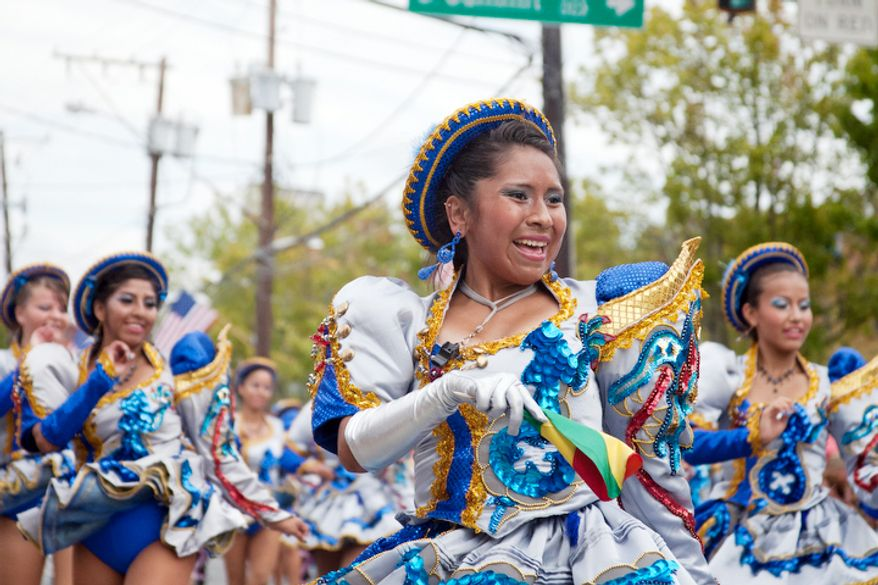 Bolivian dancers perform during the Gaithersburg Labor Day parade.  (Craig Bisacre/The Washington Times)