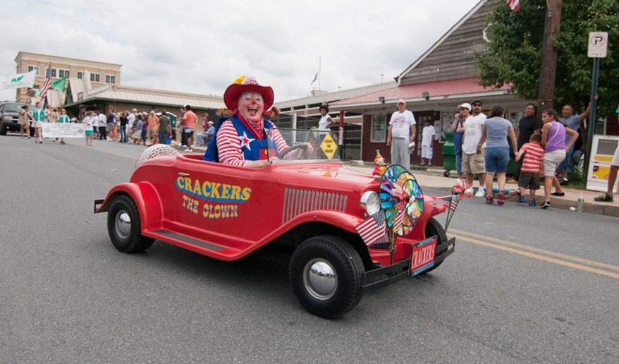 Crackers, The Clown, rides her tinny car in the Labor Day parade on Monday, Sept. 3, 2012, in Gaithersburg, Maryland.  (Craig Bisacre/The Washington Times)