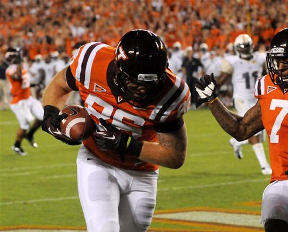 Virginia Tech's Eric Martin (86) hauls in a touchdown catch against Georgia Tech during the first half of a college football game, Monday, Sept. 3, 2012, in Blacksburg, Va. (AP Photo/Don Petersen)