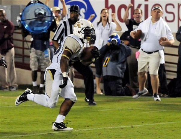 Georgia Tech's Robert Godhigh scores a touchdown against Virginia Tech during the first half of a college football game, Monday, Sept. 3, 2012, in Blacksburg, Va. (AP Photo/Don Petersen)