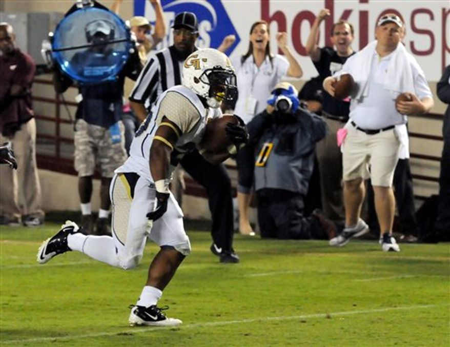 Georgia Tech's Robert Godhigh scores a touchdown against Virginia Tech during the first half of a college football game, Monday, Sept. 3, 2012, in Blacksburg, Va. (AP Photo/Don Petersen)