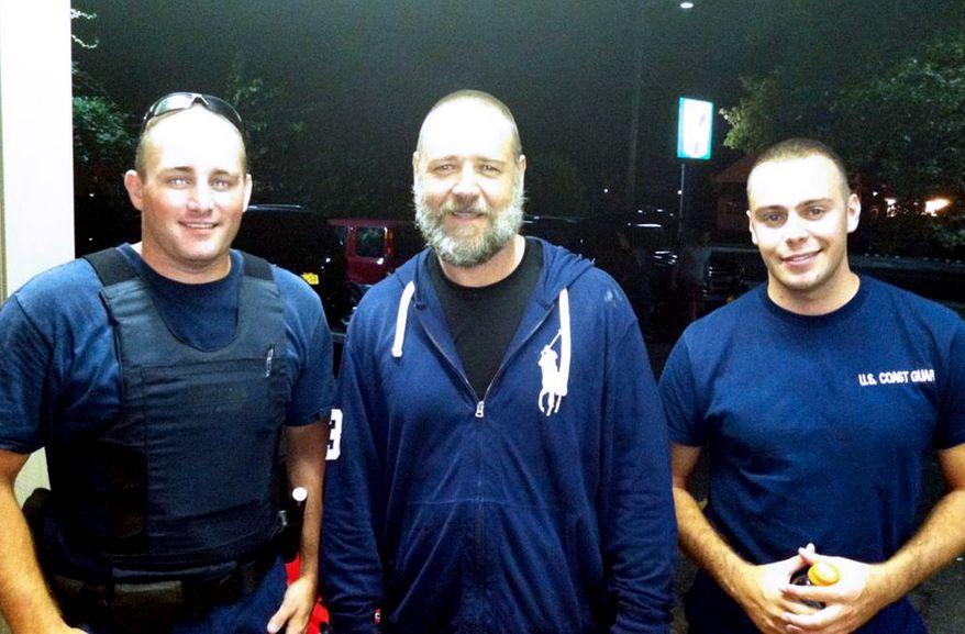 Actor Russell Crowe (center) is pictured with Coast Guard Petty Officers Robert Swieciki (left) and Thomas Watson on Sunday, Sept. 2, 2012. Mr. Crowe and a friend became disoriented while kayaking in Long Island Sound and called the Coast Guard for assistance. (AP Photo/U.S. Coast Guard)