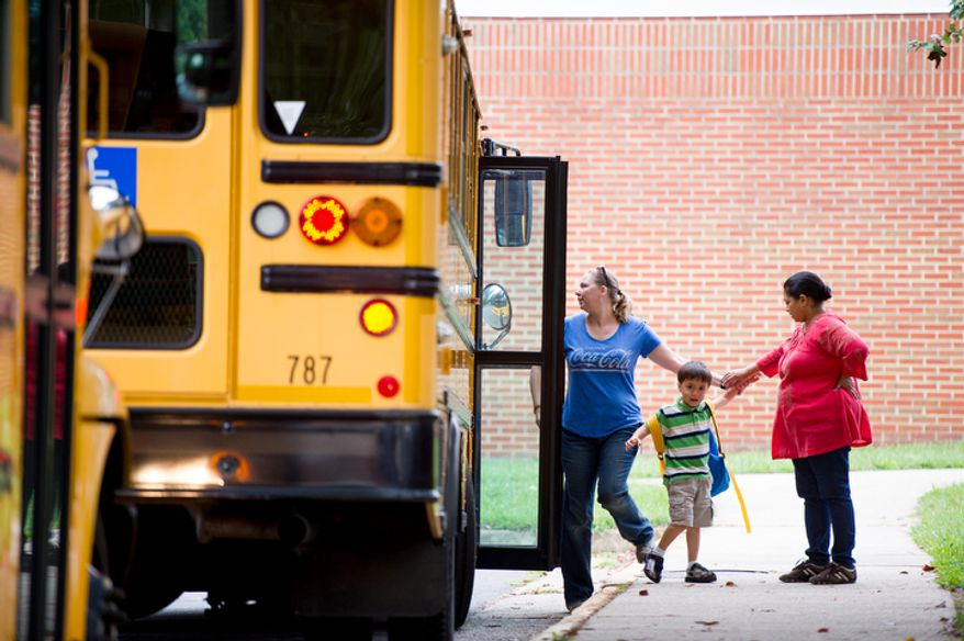 Preschool assistants Jennette Eddy and Maha Elgadi greet Vincent Nguyen, 4, as he is dropped off for pre-school on the first day back to school at North Springfield Elementary School, Springfield, Va., Tuesday, September 4, 2012. (Andrew Harnik/The Washington Times)