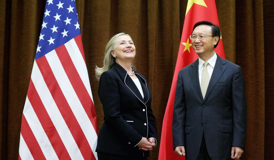 Secretary of State Hillary Rodham Clinton, meeting with Chinese Foreign Minister Yang Jiechi at the Ministry of Foreign Affairs on Tuesday, is in Beijing to press Chinese authorities to agree to a peaceful resolution of disputes with their smaller Asian neighbors over competing territorial claims in the South China Sea. (Associated Press)