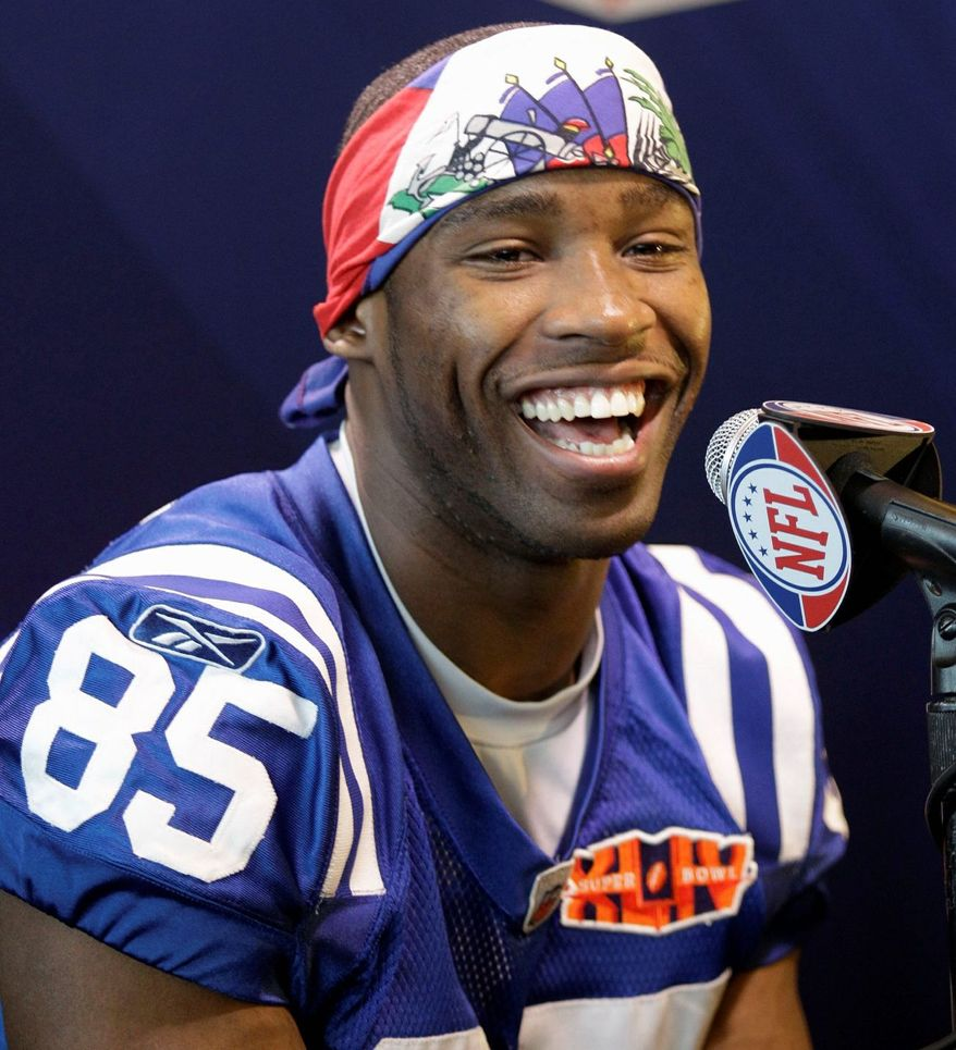 Pierre Garcon, with the Indianapolis Colts in February 2010, wore a Haitian flag and used Super Bowl Media Day as an opportunity to raise awareness of the plight of the earthquake victims. (Associated Press)