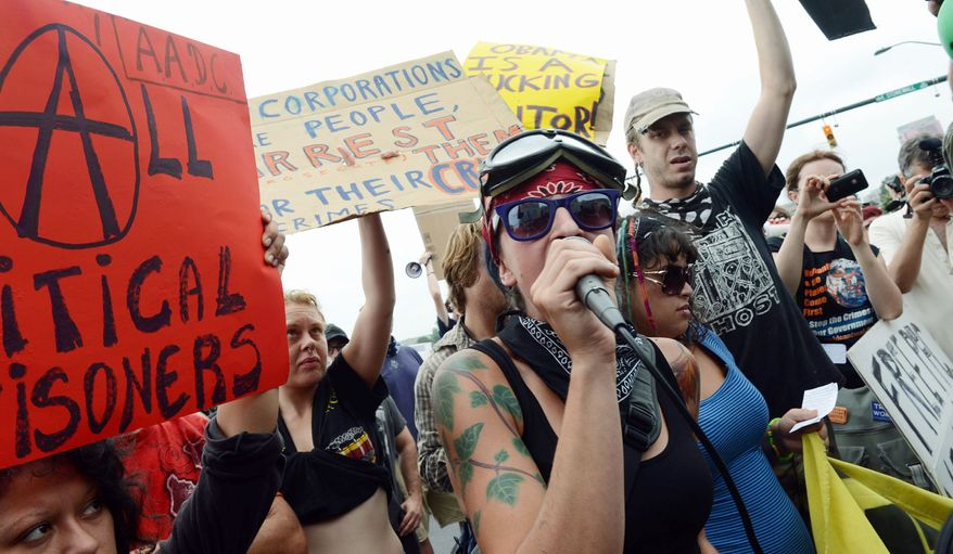Lauren Digioia (center) of New York City, a member of the Occupy Wall Street movement, addresses fellow protesters on the streets of Charlotte, N.C., outside the Democratic National Convention on Tuesday. (Barbara L. Salisbury/The Washington Times)