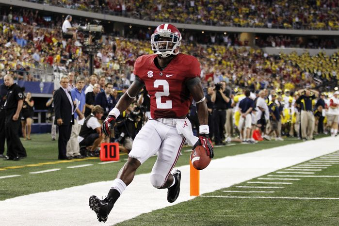 Alabama wide receiver DeAndrew White (2) runs into the end zone to score a touchdown during the first half of an NCAA college football game against the Michigan at Cowboys Stadium in Arlington, Texas, Saturday, Sept. 1, 2012. (AP Photo/LM Otero)