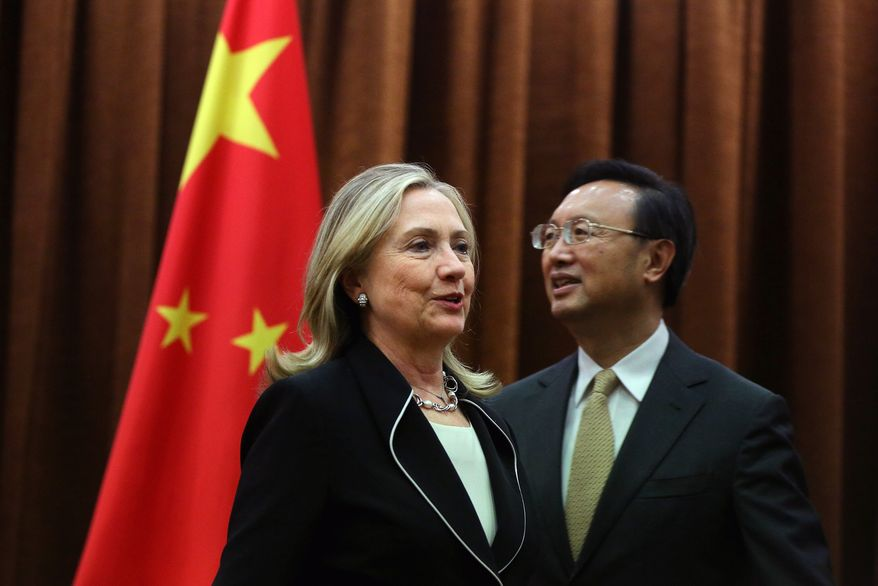 U.S. Secretary of State Hillary Rodham Clinton meets with Chinese Foreign Minister Yang Jiechi at the Ministry of Foreign Affairs in Beijing on Tuesday, Sept. 4, 2012. Mrs. Clinton is in China's capital to press Chinese authorities to agree to peacefully resolve disputes with their smaller neighbors over competing territorial claims in the South China Sea. (AP Photo/Feng Li, Pool)
