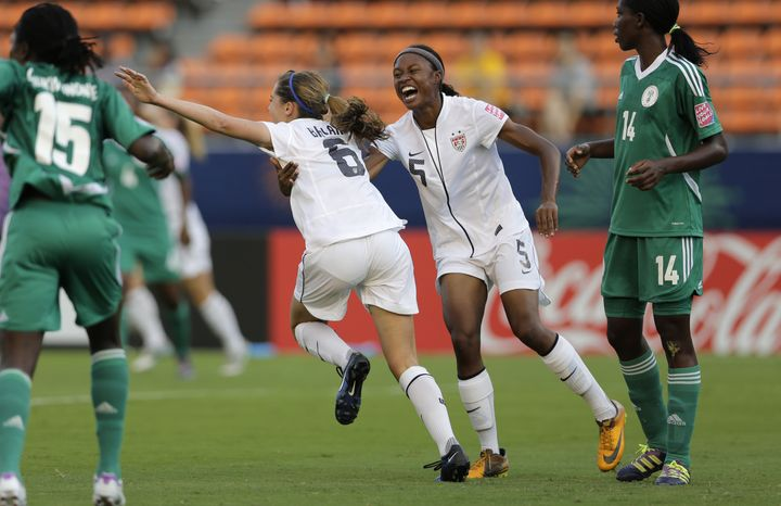 CORRECTS NAME OF OSHOALA - Morgan Brian (6) of the U.S., celebrates with teammate Maya Hayes after scoring her team's first goal against Nigeria during their semifinal soccer match of the U-20 women's World Cup in Tokyo, Tuesday, Sept. 4, 2012.  At left is Nigeria's Josephine Chukwunonye (15), and Asisat Oshoala at right. (AP Photo/Shizuo Kambayashi)