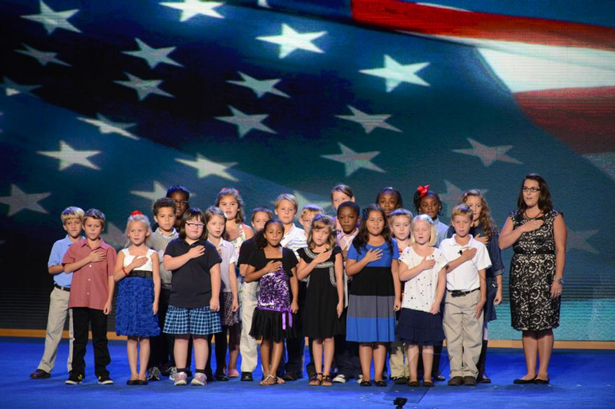The third-grade class of the W.R. O'Dell Elementary School in Concord, N.C., recite the Pledge of Allegiance at the opening of the Democratic National Convention in Charlotte, N.C., on Tuesday, Sept. 4, 2012. (Andrew Geraci/The Washington Times)