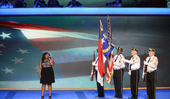 "Amber Riley, singer/songwriter and ""Glee"" actress, sings the National anthem before a color guard of Disabled American Veterans of The Stanly County Chapter 12 Honor Guard the Democratic National Convention. (Andrew Geraci/ The Washington Times)"