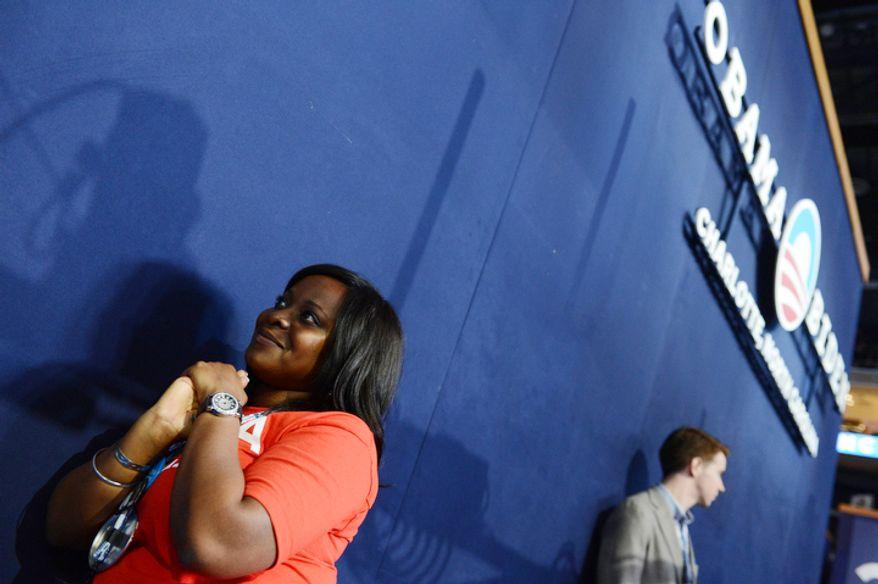 Texas delegate Trisha Frederick, of Houston, Tex., listens to speeches at the Democratic National Convention. (Barbara Salisbury/ The Washington Times)