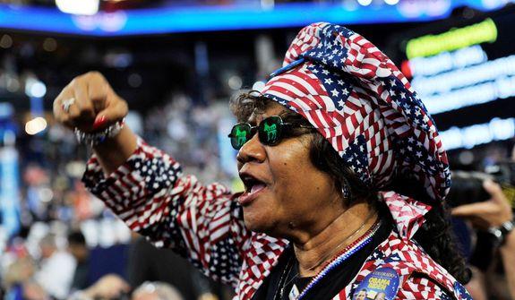 Colorado delegate Julia Hicks applauds as Cory A. Booker-D, Mayor of Newark, N.J. addresses the Democratic National Convention. (Barbara Salisbury/ The Washington Times)