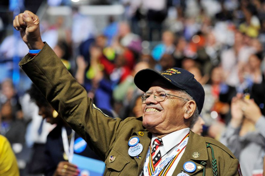 World War Two veteran and California delegate Stephen E. Sherman of Los Angeles, Calif., applauds as Cory A. Booker-D, Mayor of Newark, N.J. addresses the Democratic National Convention (Barbara Salisbury/ The Washington Times)