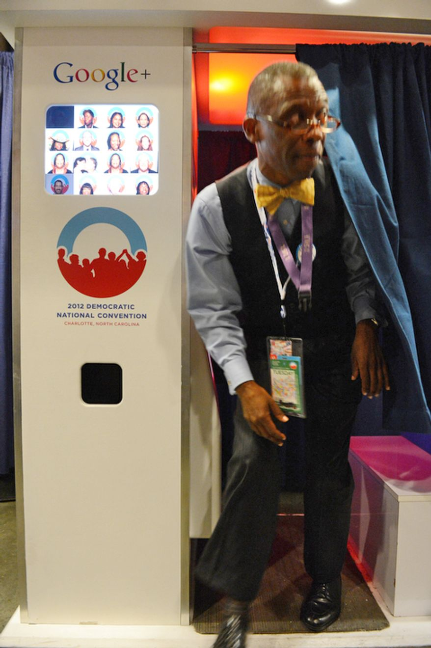 William Gordner, of Atlanta, Ga. emerges from the Google Photo Booth. (Barbara Salisbury/ The Washington Times)