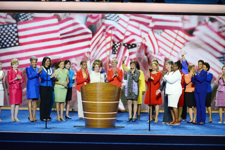 Rep. Nancy Pelosi, Democratic Leader and Member of the US House of Representatives, California leads a group of congressional women; The Honorable Rosa L. DeLauro, Member of the US House of Representatives, Connecticut, The Honorable Carolyn B. MaloneyMember of the US House of Representatives, New York, The Honorable Allyson Schwartz, Member of the US House of Representatives, Pennsylvania, The Honorable Gwen MooreMember of the US House of Representatives, Wisconsin,The Honorable Nydia M. Vel·zquezMember of the US House of Representatives, New York, Tulsi Gabbard Candidate for the US House of Representatives, Hawaii, Joyce BeattyCandidate for the US House of Representatives, Ohio, address the Democratic National Convention at the Time Warner Arena in Charlotte, N.C., on Tuesday, September 4, 2012. (Andrew Geraci/ The Washington Times)