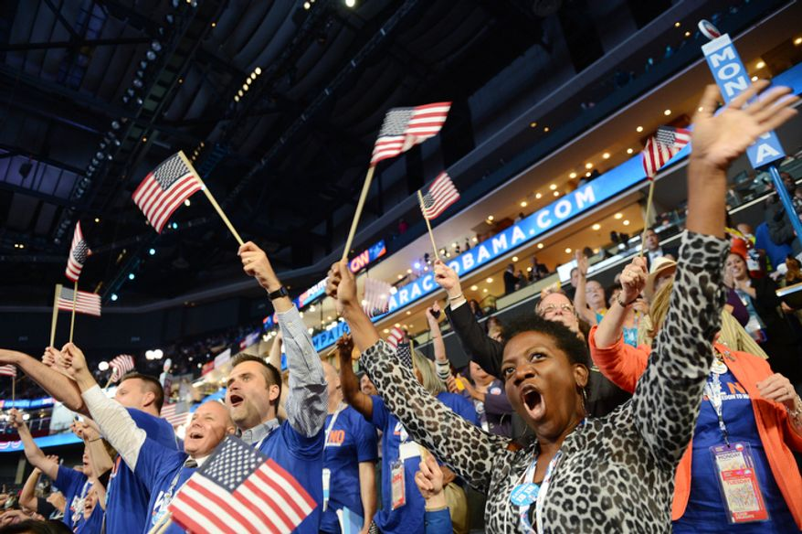 Minnesota delegate Katrina Wilder, from St. Cloud, Minn., cheers a speaker during the first night of the Democratic National Convention. (Barbara Salisbury/ The Washington Times)