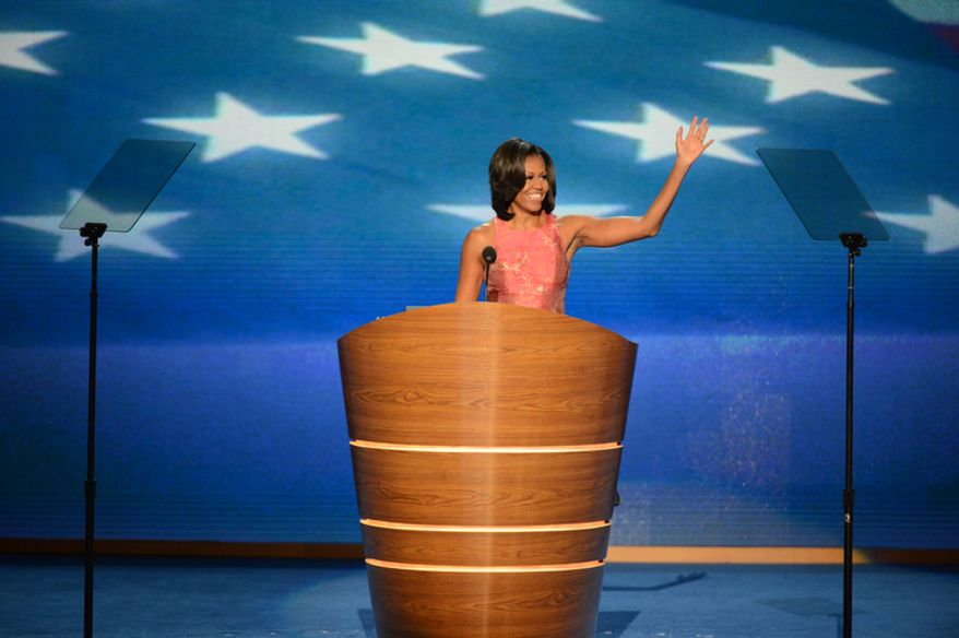 First Lady of the United States Michelle Obama addresses the Democratic National Convention on its opening night at the Time Warner Arena in Charlotte, N.C., on Tuesday, September 4, 2012. (Andrew Geraci/ The Washington Times)