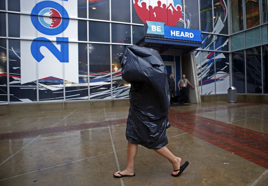 A delegate arrives Sept. 4, 2012, at the Democratic National Convention in Charlotte, N.C., during a downpour. (Associated Press)