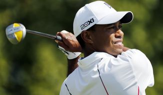 Tiger Woods tees off on the first hole during the third round of the Deutsche Bank Championship PGA golf tournament at TPC Boston in Norton, Mass., Sunday, Sept., 2, 2012. (AP Photo/Michael Dwyer)