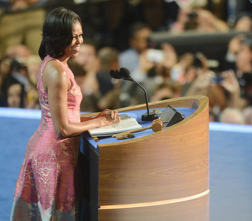First lady Michelle Obama addresses the Democratic National Convention on Sept. 4, 2012, its opening night, at the Time Warner Arena in Charlotte, N.C. (Barbara L. Salisbury/The Washington Times)