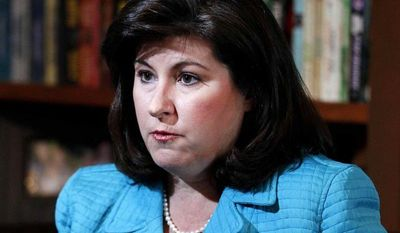 ** FILE ** This Feb. 7, 2012, file photo shows Karen Handel, former vice president for public policy for Susan G. Komen for the Cure breast-cancer charity, speaking during an interview in Atlanta. Handel, the former Susan G. Komen executive at the heart of the organization's clash with Planned Parenthood, has a book deal. (AP Photo/John Bazemore, file)